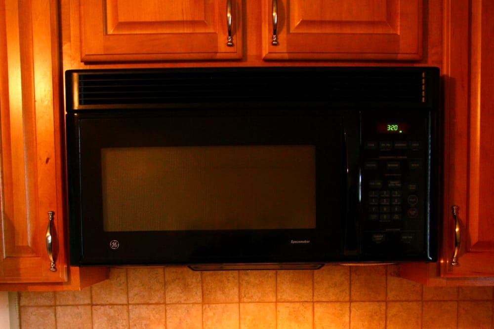 A microwave at Brookview Manor Apartments