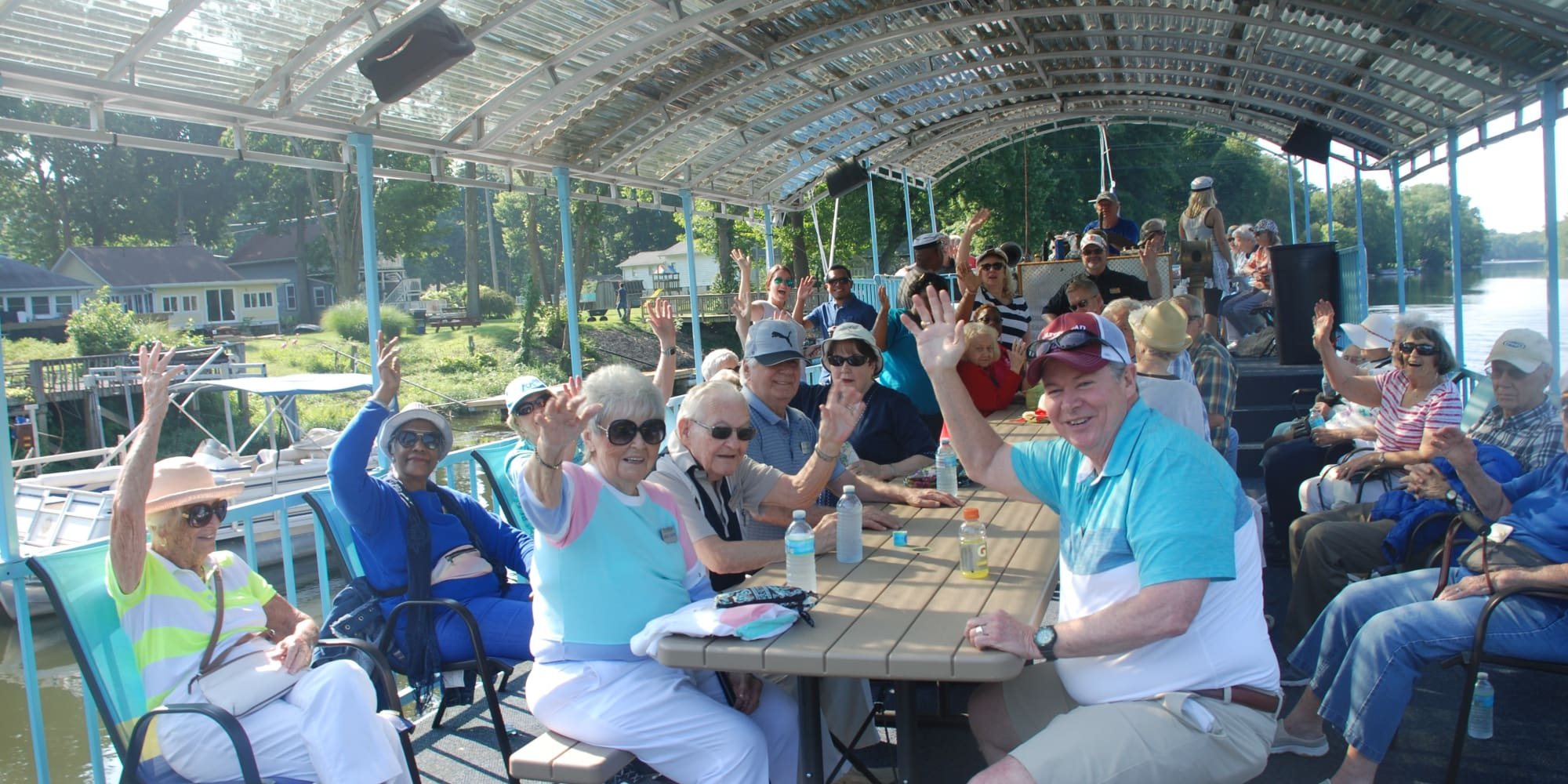 A group of residents from Heatherwood Gracious Retirement Living in Tewksbury, Massachusetts on a boat