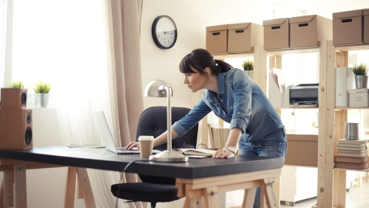 Woman standing at well-organized desk