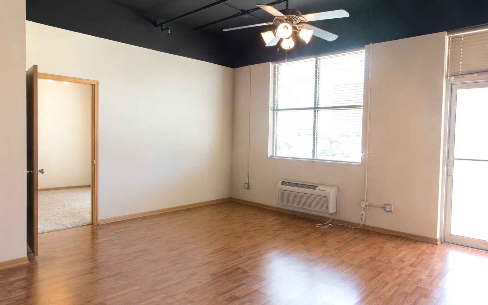 Living room with air conditioning in a single bedroom apartment at West Towne in Ames, Iowa
