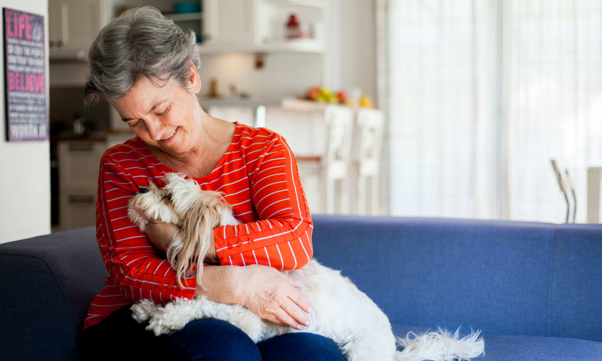 A woman with their dog at Broadwell Senior Living in Plymouth, Minnesota