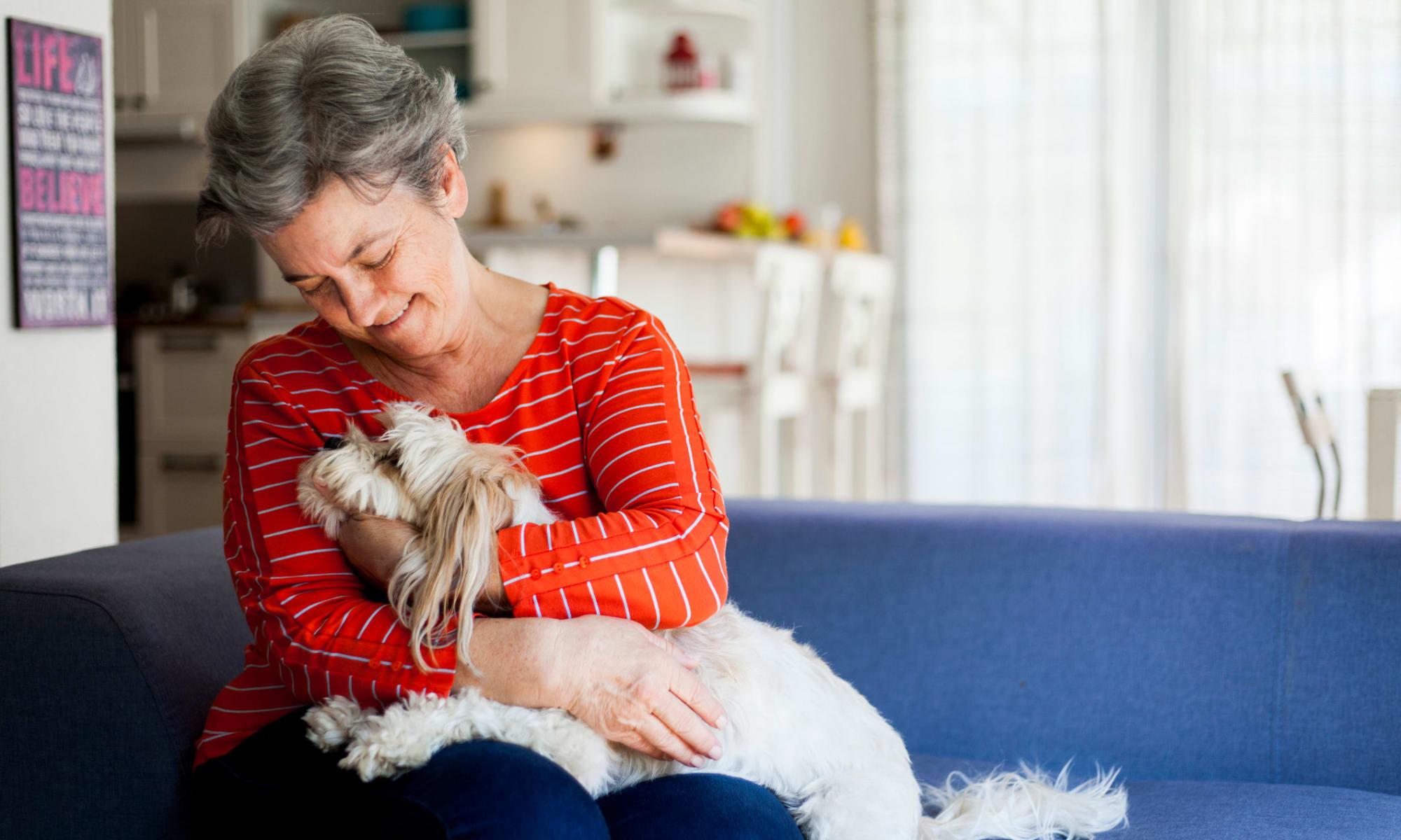 A woman with their dog at Broadwell Senior Living in Kearney, Nebraska