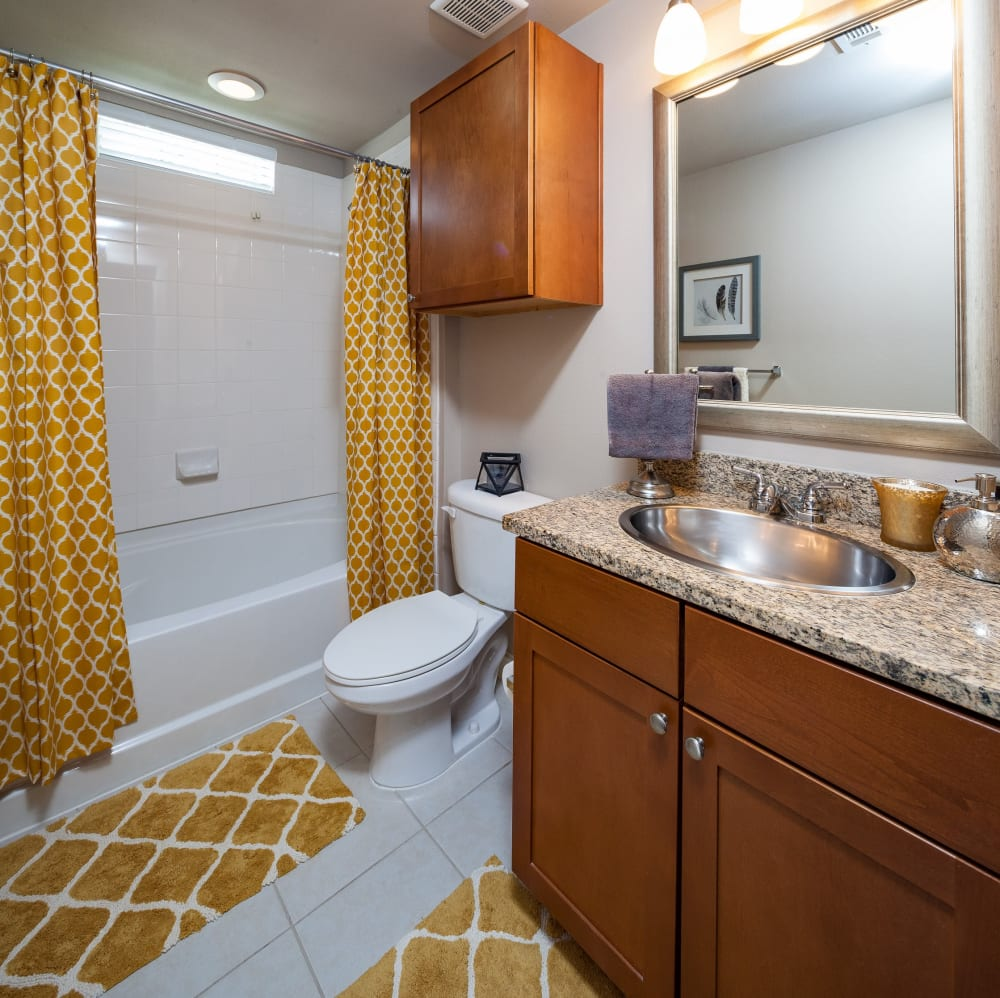 Spacious bathroom with an oval tub at Lakefront Villas in Houston, Texas
