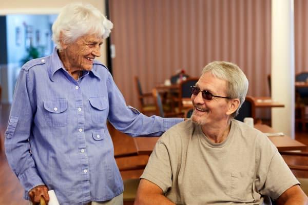 Happy residents enjoying conversation at Dayspring Villa