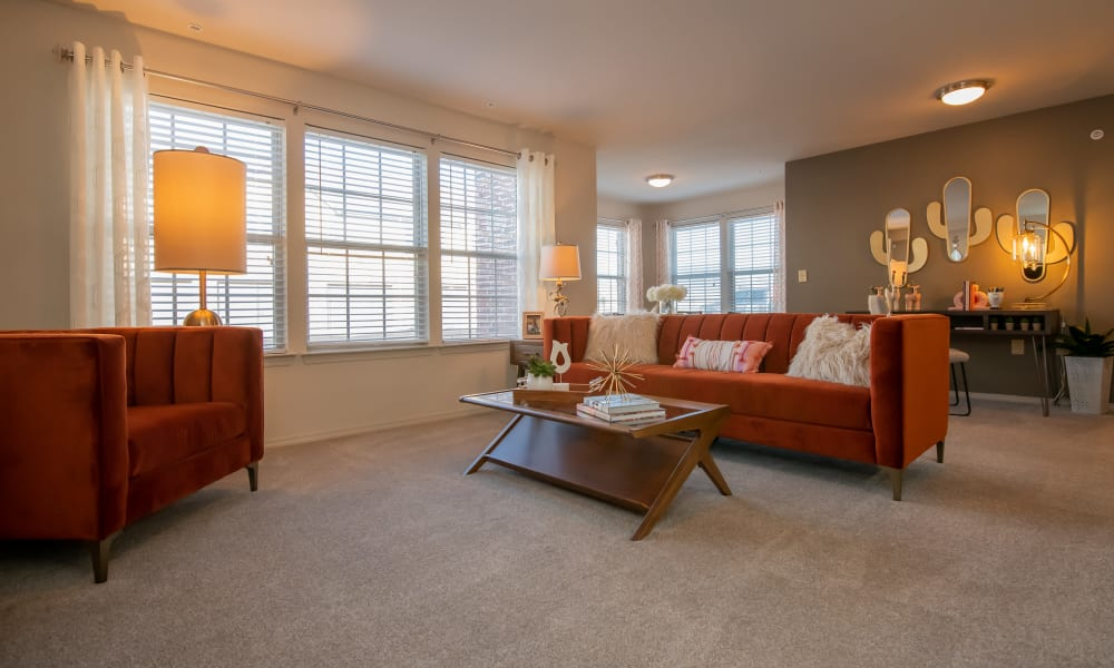 Spacious living room with extra space at Portico at Friars Creek Apartments in Temple, Texas