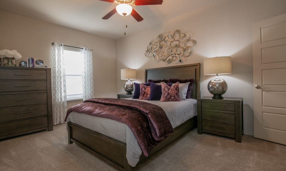 Bedroom with a ceiling fan at Stonehorse Crossing Apartments in Oklahoma City, Oklahoma