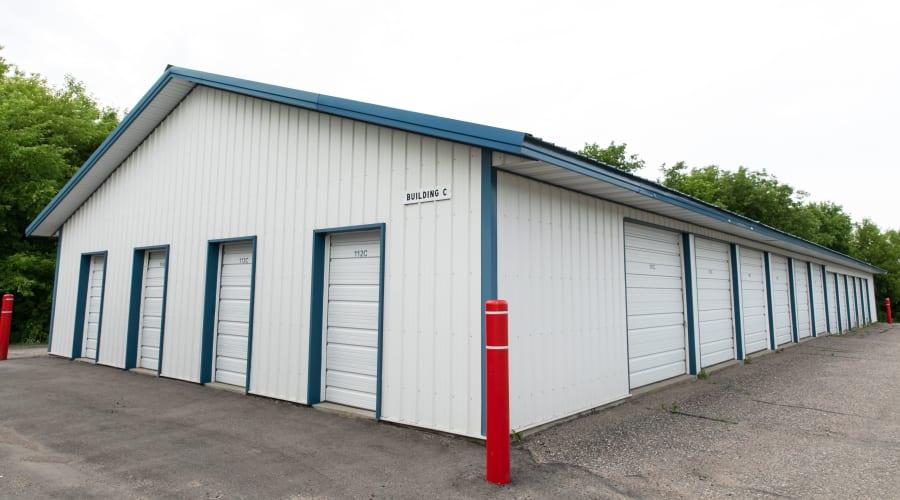 Storage units with blue doors and locks at KO Storage of Maple Lake - Cenex in Maple Lake, Minnesota