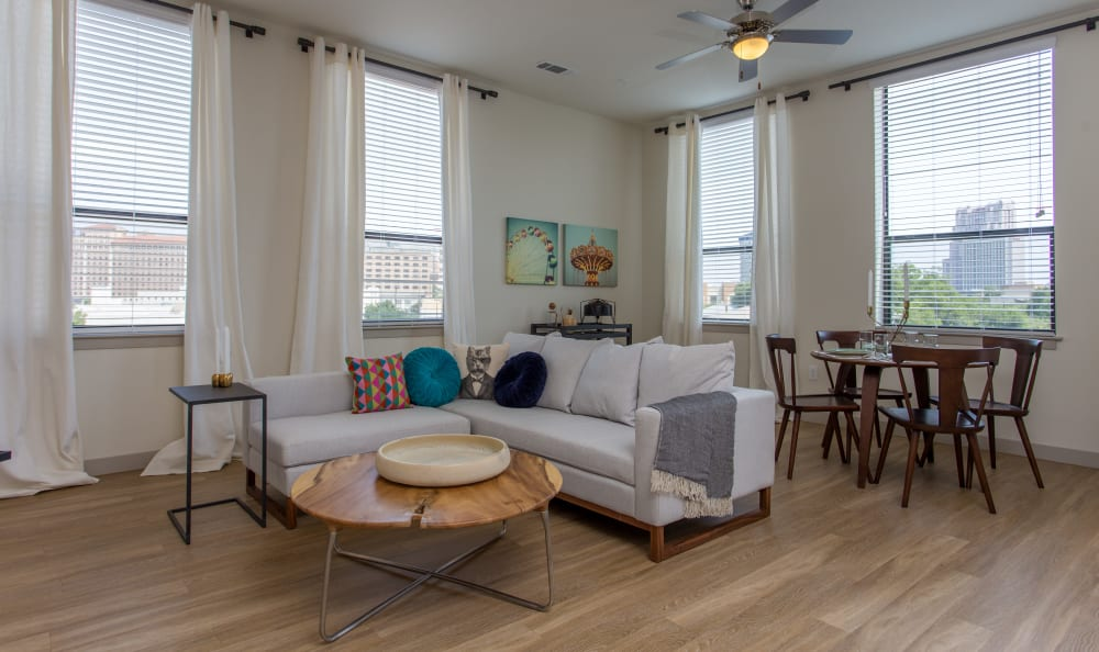 Open-concept layout with hardwood floors in a model home at Agave in San Antonio, Texas