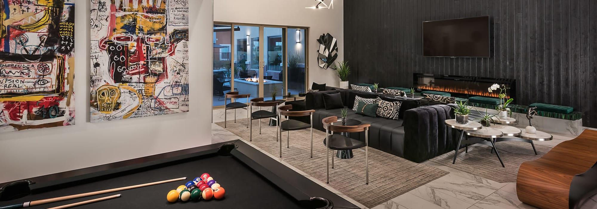 Community clubhouse featuring lounge and billiards table at Villa Vita Apartments