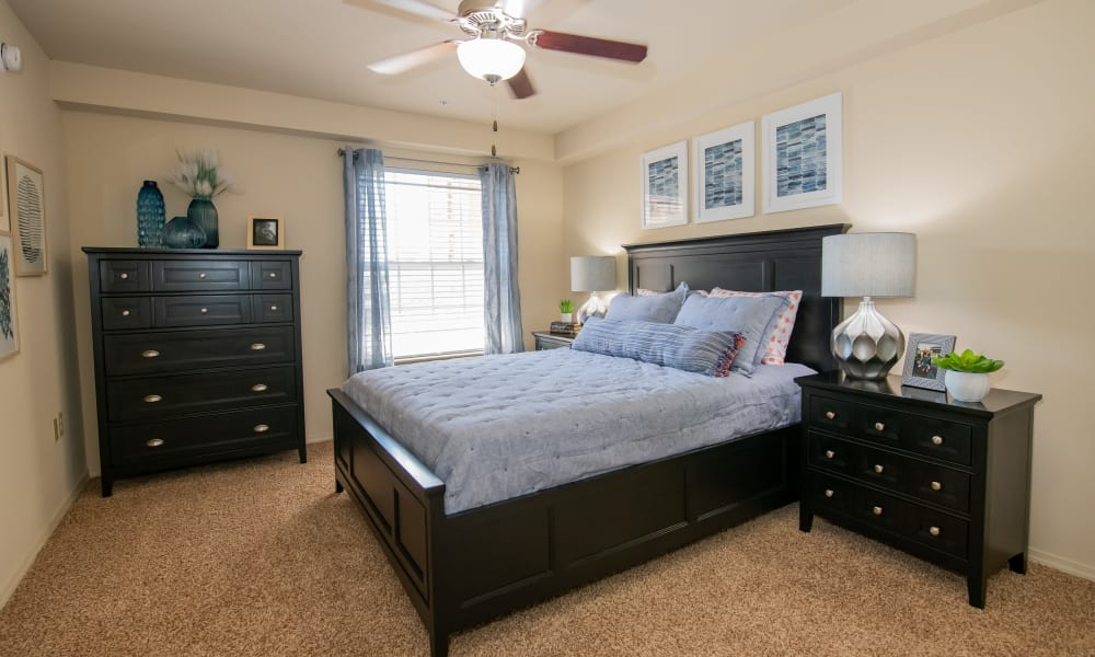 Large bedroom with ceiling fan at Coffee Creek Apartments in Owasso, Oklahoma