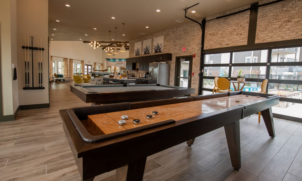 Game area at Bend at New Road Apartments in Waco, Texas