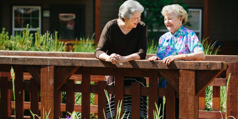 Residents talking while enjoying the beautiful scenery outside the facility at The Springs at Missoula in Missoula, Montana