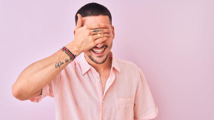 Man wearing pink shirt.