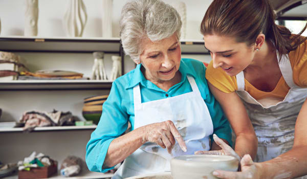 A resident and her daughter baking at Amaran Senior Living in Albuquerque, New Mexico.
