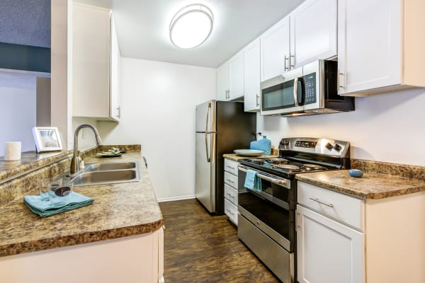 Kitchen layout in a model apartment home at Olive Ridge in Pomona, California