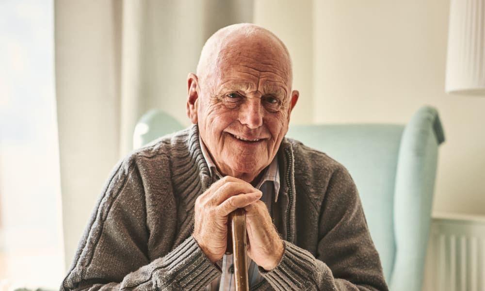 A resident with a cane poses for a picture at Ativo Senior Living of Prescott Valley in Prescott Valley, Arizona.