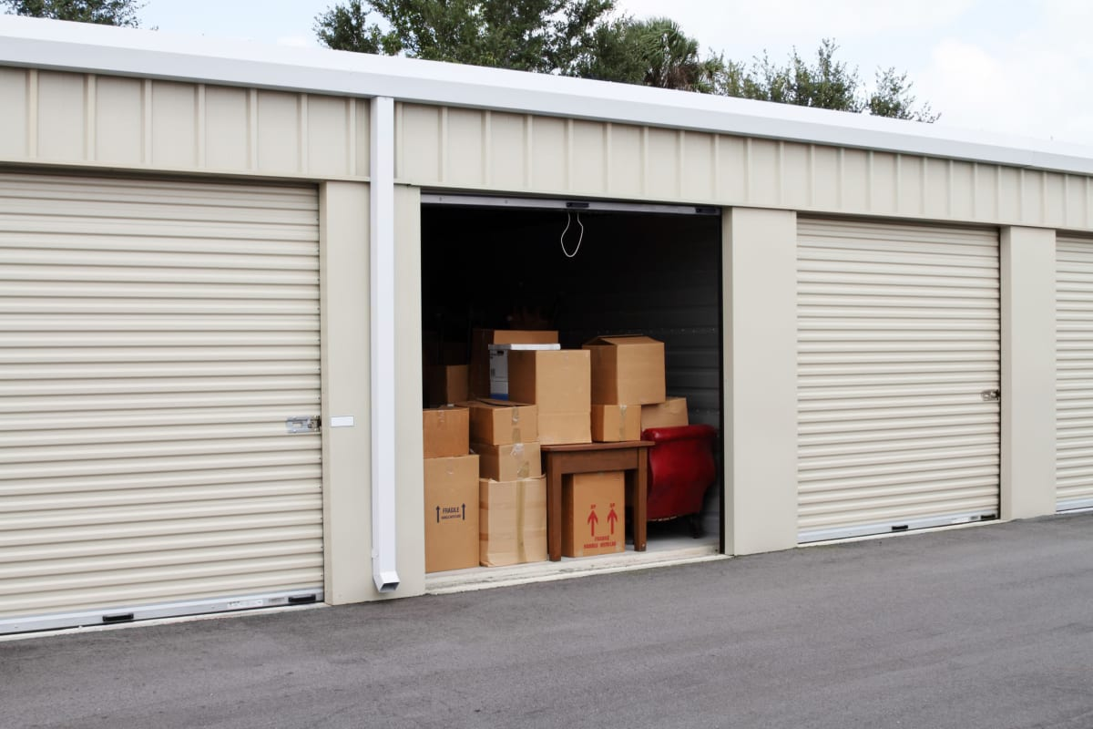 A storage unit with boxes at Red Dot Storage in Huntsville, Alabama