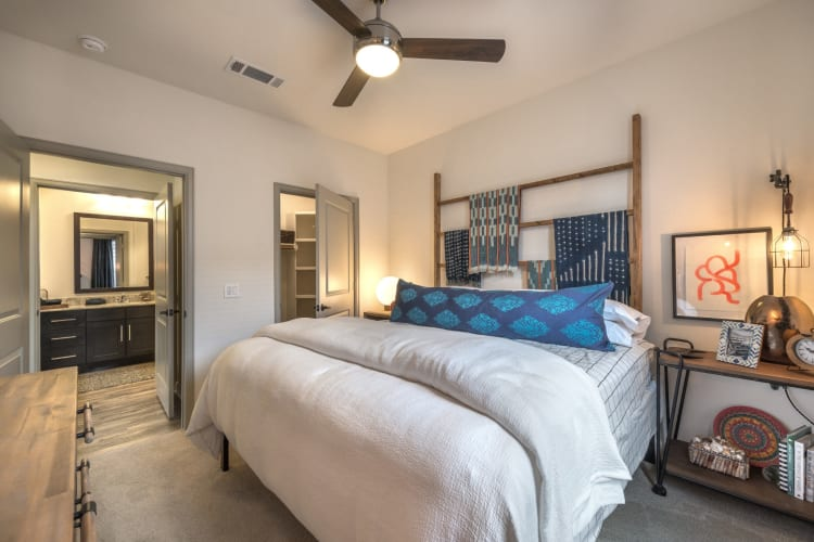 Furnished bedroom with large walk in closet at Mercantile River District in Fort Worth, Texas