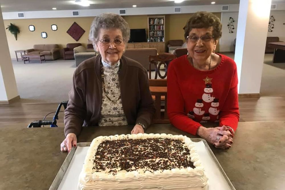 Residents celebrating their birthday with cake at Allouez Sunrise Village in Green Bay, Wisconsin