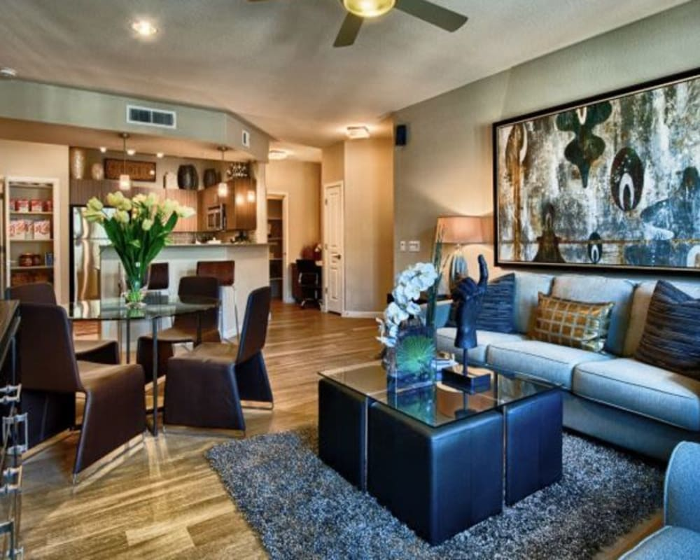Modern furnishings in a model home's open-concept living area at Elevation Chandler in Chandler, Arizona