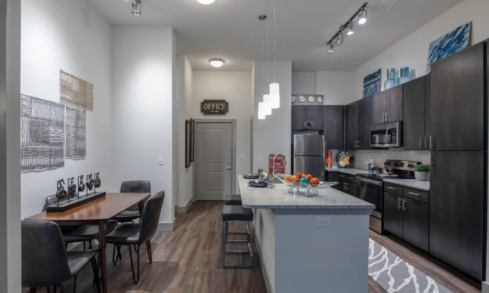 Kitchen with island for cooking and eating on at Bellrock Upper North in Haltom City, Texas