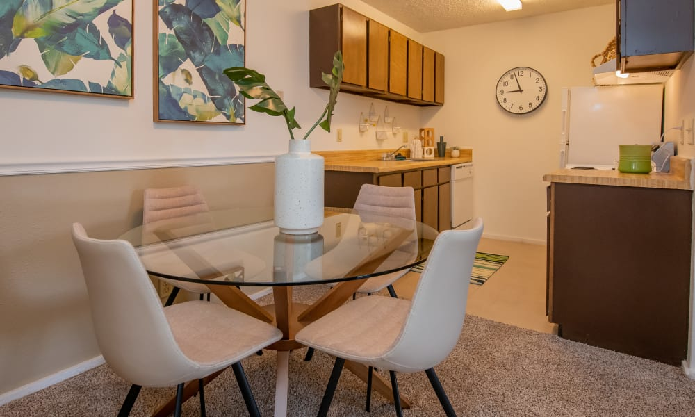Open dining room and kitchen at Fox Run Apartments in Wichita, Kansas