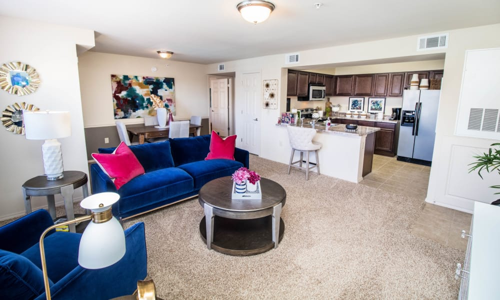 Spacious living room with plush carpet at Tuscany Place in Lubbock, Texas.
