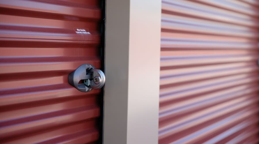A red storage unit with a lock at KO Storage of Portage - East in Portage, Wisconsin