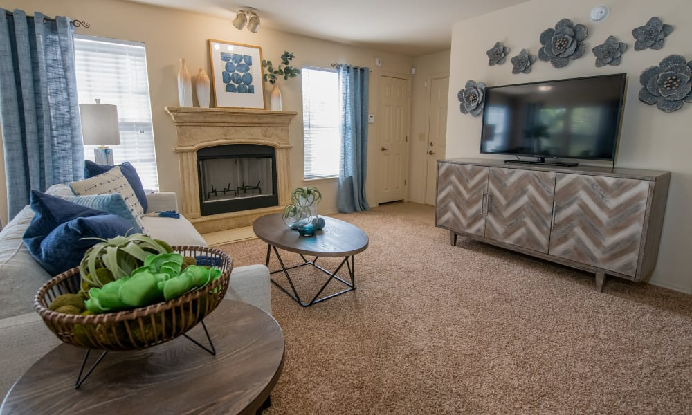 Large windows in living room at Coffee Creek Apartments in Owasso, Oklahoma