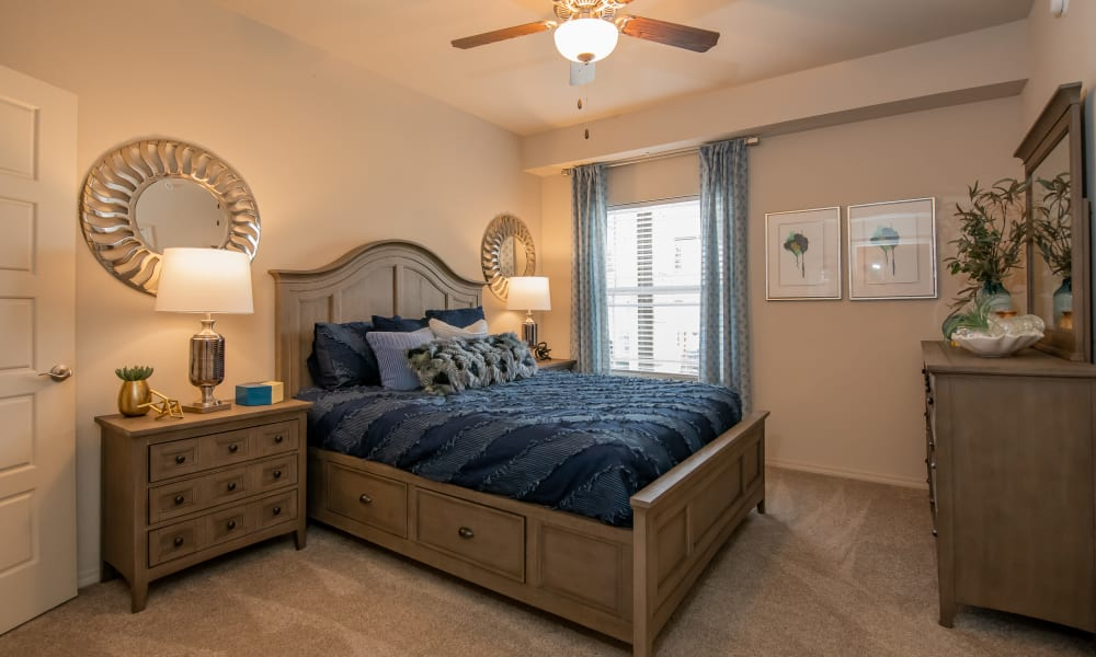 Cozy bedroom at Bend at New Road Apartments in Waco, Texas