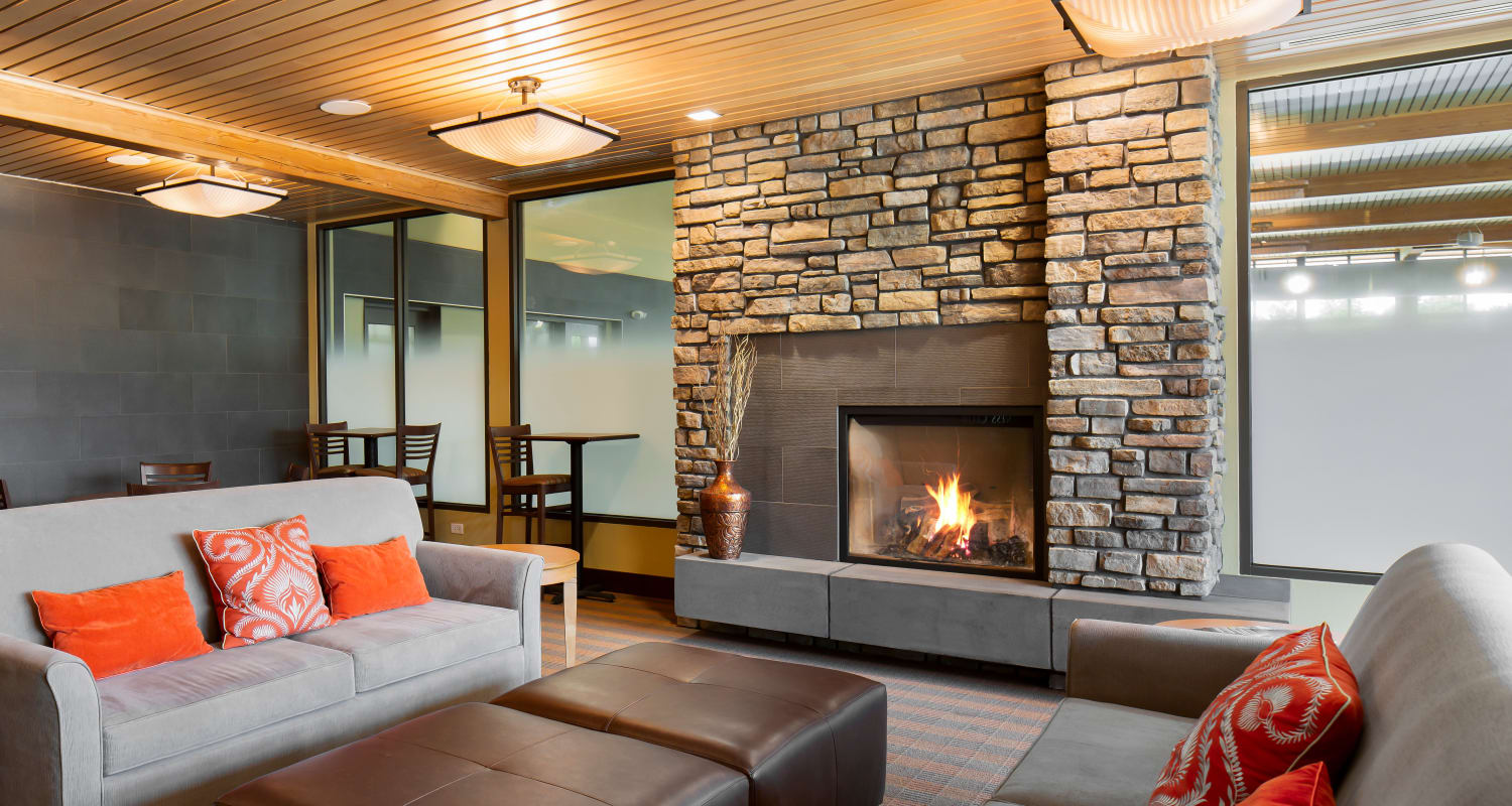 Fireside seating at Touchmark at Meadow Lake Village Health & Fitness Club in Meridian, Idaho