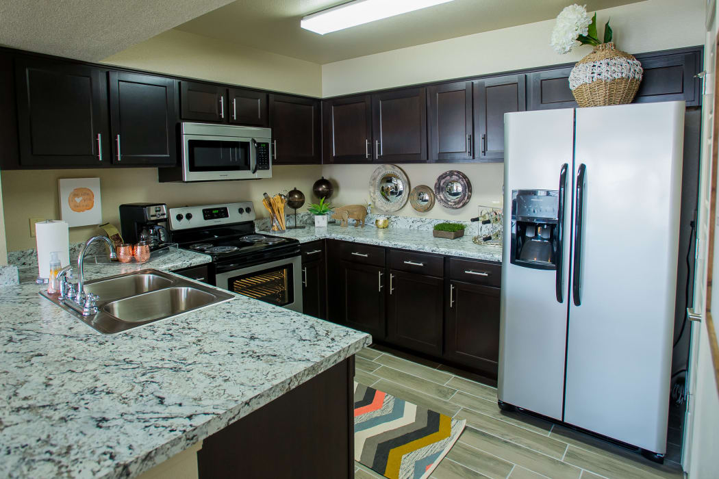 Fully equipped kitchen at Portico at Friars Creek Apartments in Temple, Texas