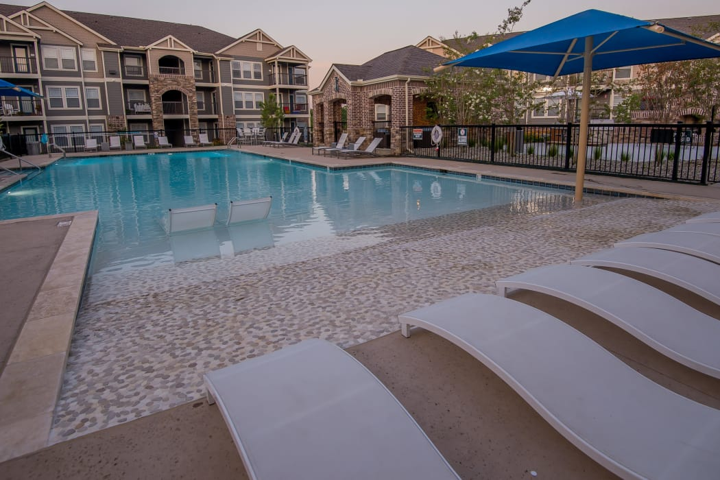 Poolside seating at Cedar Ridge Apartments in Broken Arrow, Oklahoma