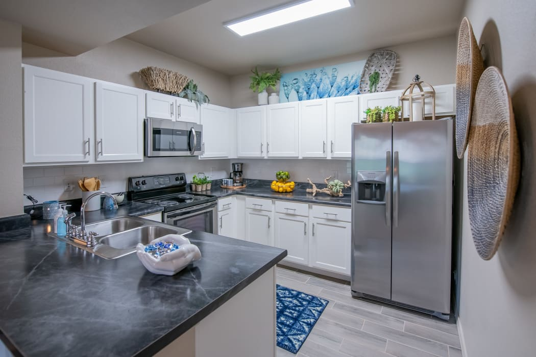 Kitchen with stainless-steel appliances at Stonehorse Crossing Apartments in Oklahoma City, Oklahoma