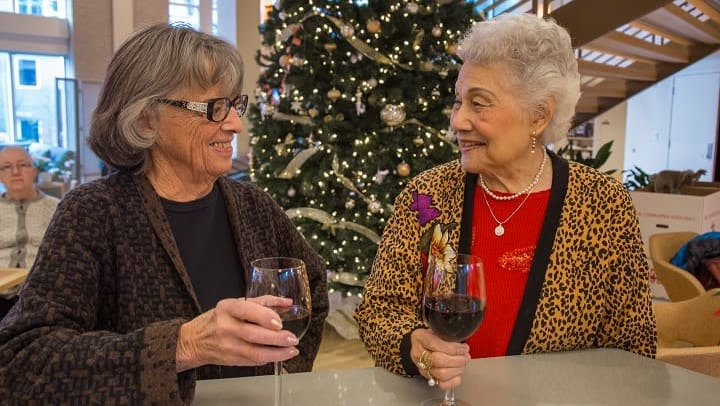 Friends having a glass of wine at our senior living community
