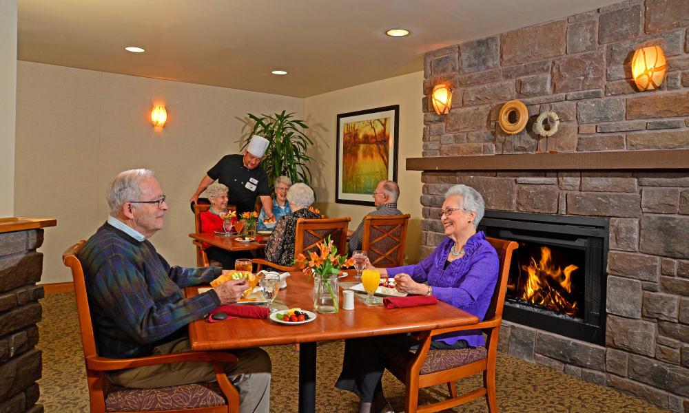 Seniors having breakfast in the dining room at Quail Park at Browns Point in Tacoma, Washington