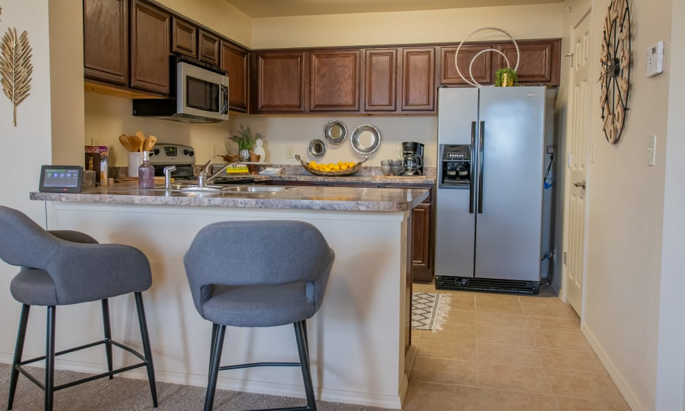 An apartment kitchen at Tuscany Hills in Tulsa, Oklahoma