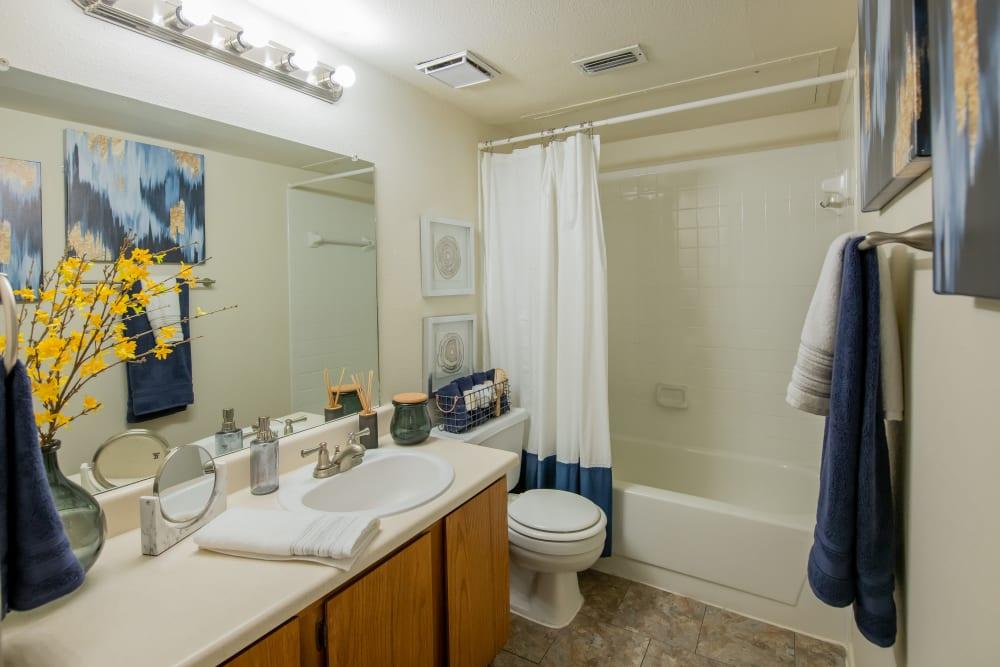 Well-lit bathroom at Newport Apartments in Amarillo, Texas