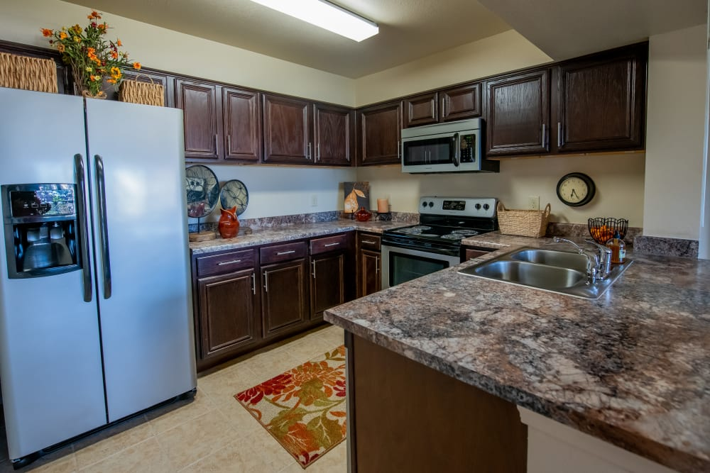 Airy kitchen with ample countertops at Park at Tuscany in Oklahoma City, Oklahoma