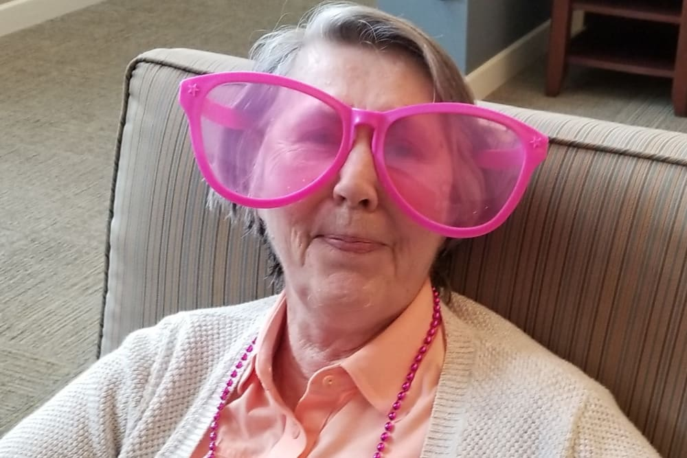 Resident with silly glasses at Emery Place in Robins, Iowa