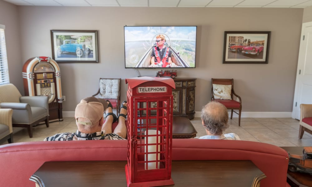Two residents watching a movie at Inspired Living Hidden Lakes in Bradenton, Florida.