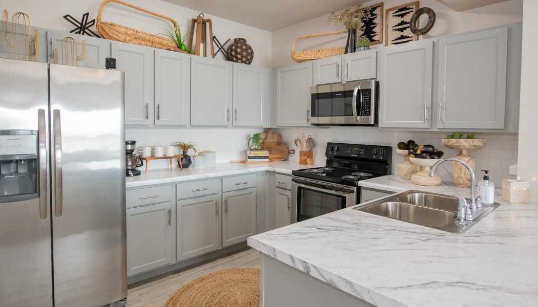 Kitchen with tons of natural light at Artisan Crossing in Norman, Oklahoma