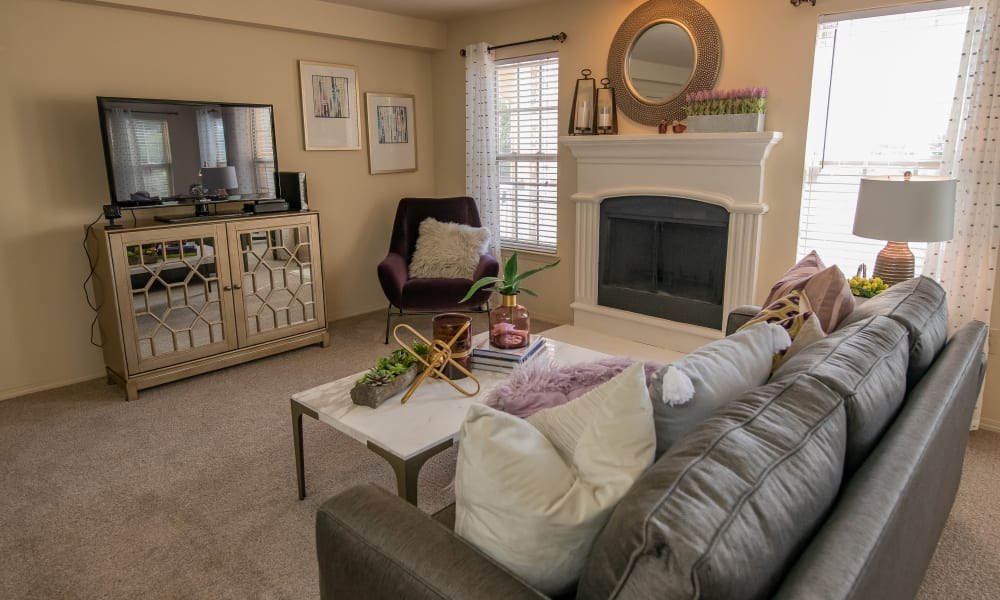 A living room with fireplace at Tuscany Hills in Tulsa, Oklahoma