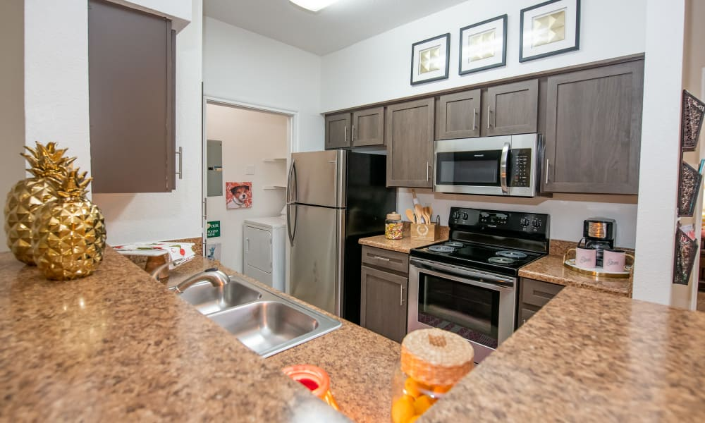 An apartment kitchen at Arbors of Pleasant Valley in Little Rock, Arkansas