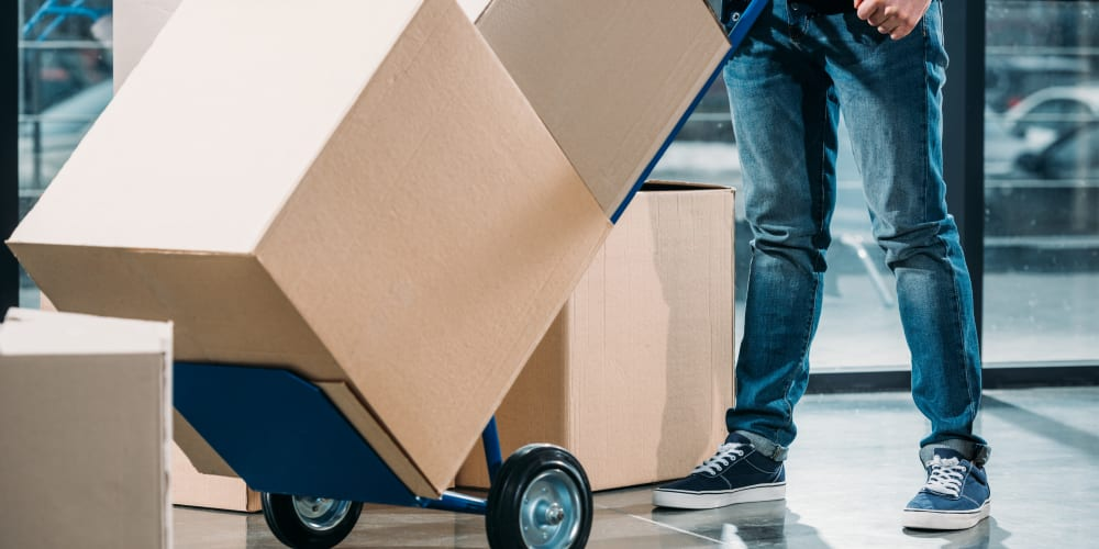A customer uses a complimentary dolly to easily move large boxes at 101 Storage in Valley Village, California