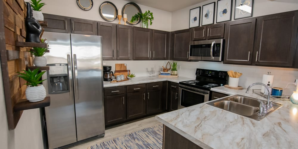 Beautiful new kitchen with breakfast bar at Artisan Crossing in Norman, Oklahoma