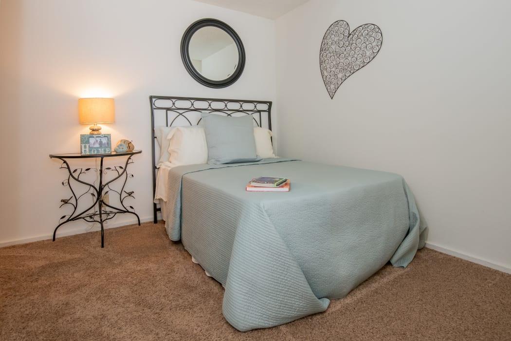 Well-lit bedroom at Fox Run Apartments in Wichita, Kansas
