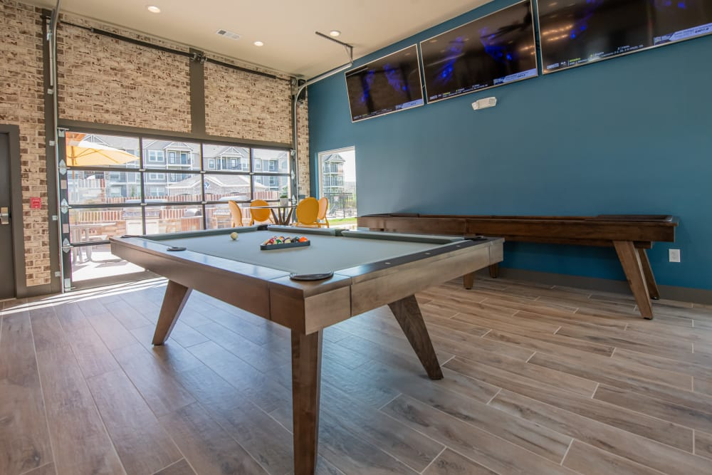 Shuffle board and pool table in clubhouse at Cottages at Crestview in Wichita, Kansas