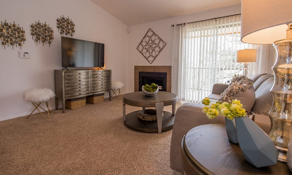 Living room with vaulted ceilings and fireplace at Windsail Apartments in Tulsa, Oklahoma