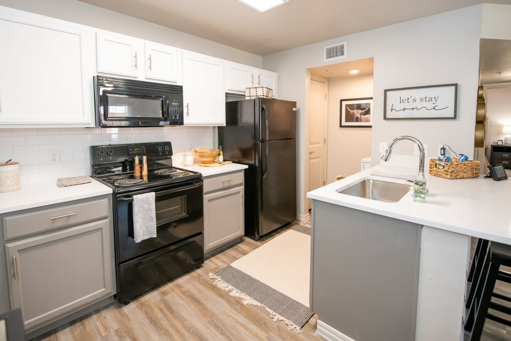 An apartment kitchen at Cross Timber in Oklahoma City, Oklahoma